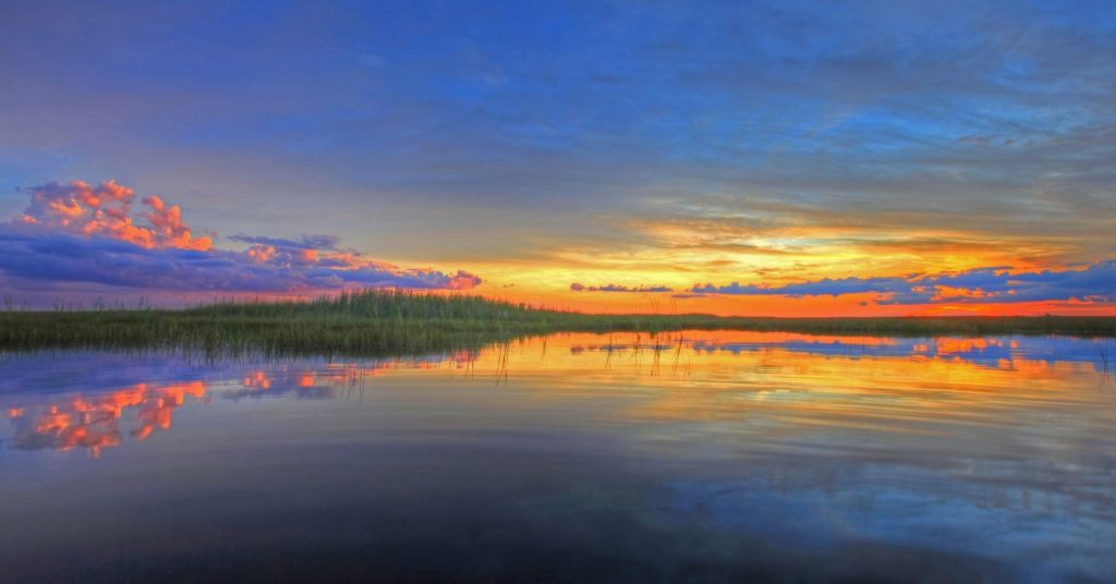 colorful clouds over swamp